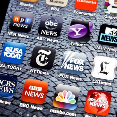 Istanbul, Turkey - June 01, 2011: Apple Iphone 4 screen with news applications including Yahoo News, NYTimes, LATimes, Fox News, USA Today, ABC News, NPR News, MTV News, CBS News, BBC News, MSNBC, WSJ, Guardian and Breaking News.